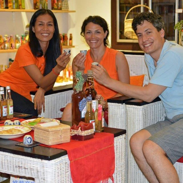 Free tasting of artisan liqueur with paintings of Angkor Wat, Bayon face, Apsara