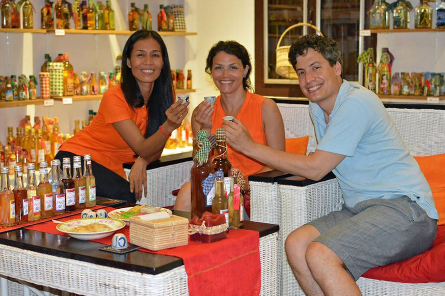Have a Sombai tasting and choose bottles made by painting artisans Angkor Bayon Souvenirs Siem Reap